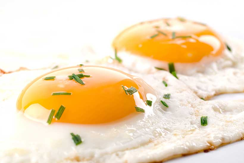 Picture of two fried eggs - a good source of vitamin A.