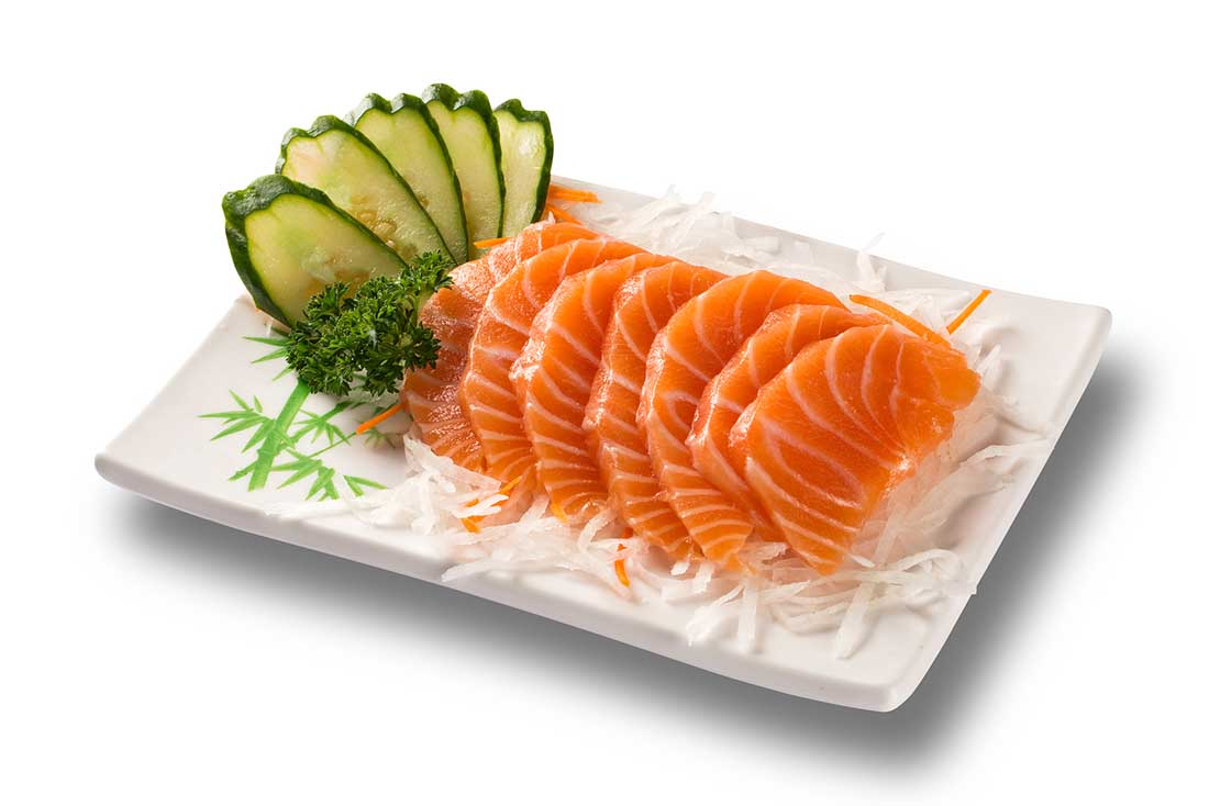 Salmon Sashimi and Cucumber Slices On a White Plate - Japanese Food.