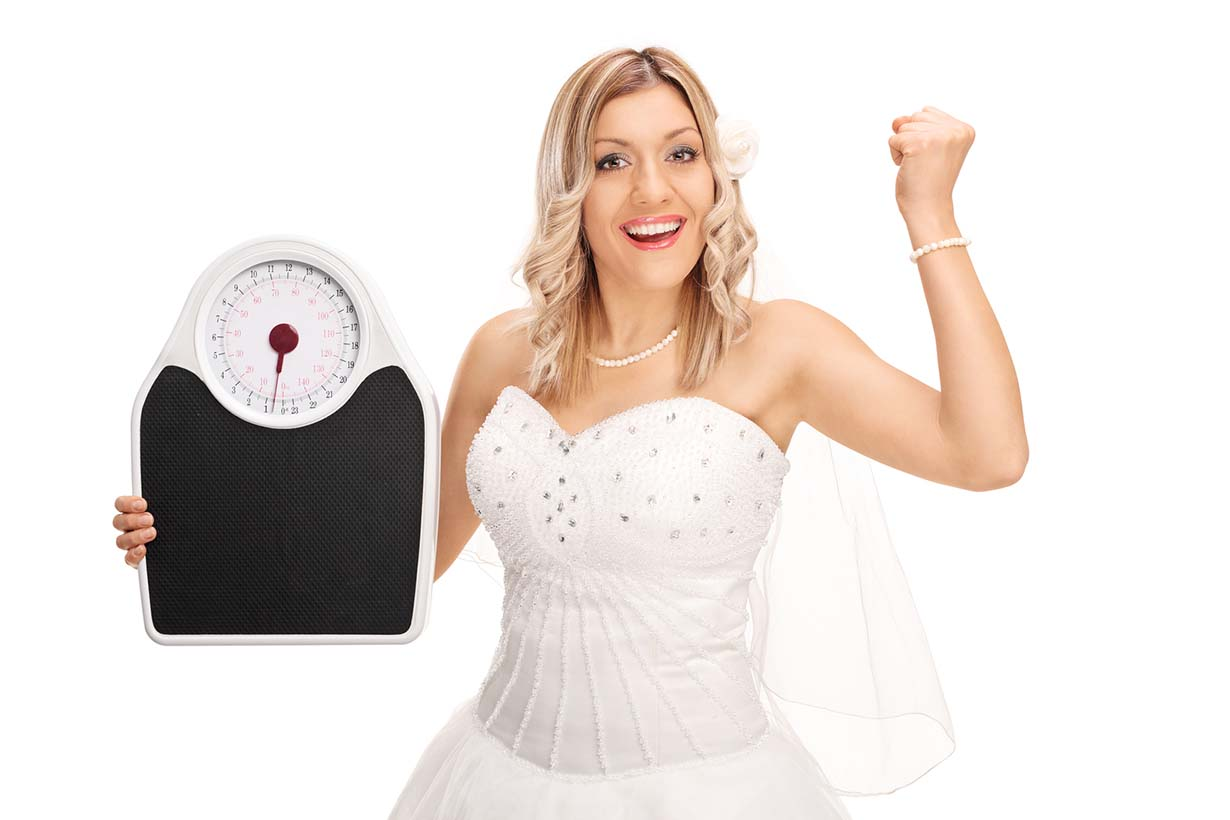Picture showing a woman who is happy that she lost weight on her diet.