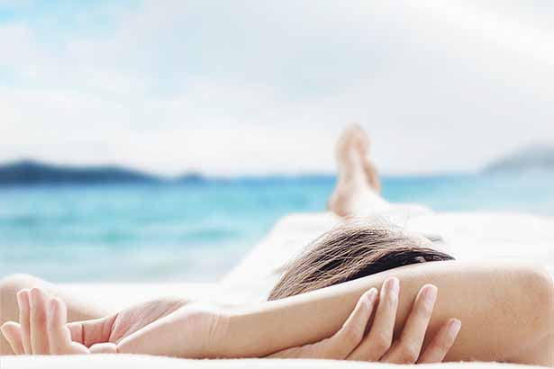 Picture of a woman using stress management techniques - relaxing.