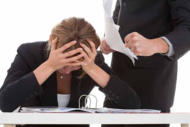 Picture of an angry boss bullying his employee. Stress theme.
