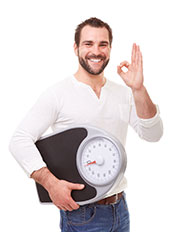 Picture of a Happy Slim Man Holding a Weight Scale.