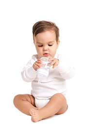Picture of a baby with commercial baby food formula