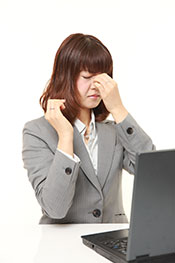 Picture of a Stressed Young Office Woman; Reducing Stress Helps Fight Inflammation.