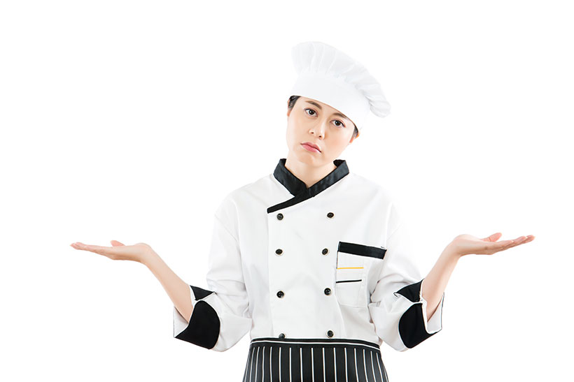 Picture of an Asian Female Chef Looking Confused.