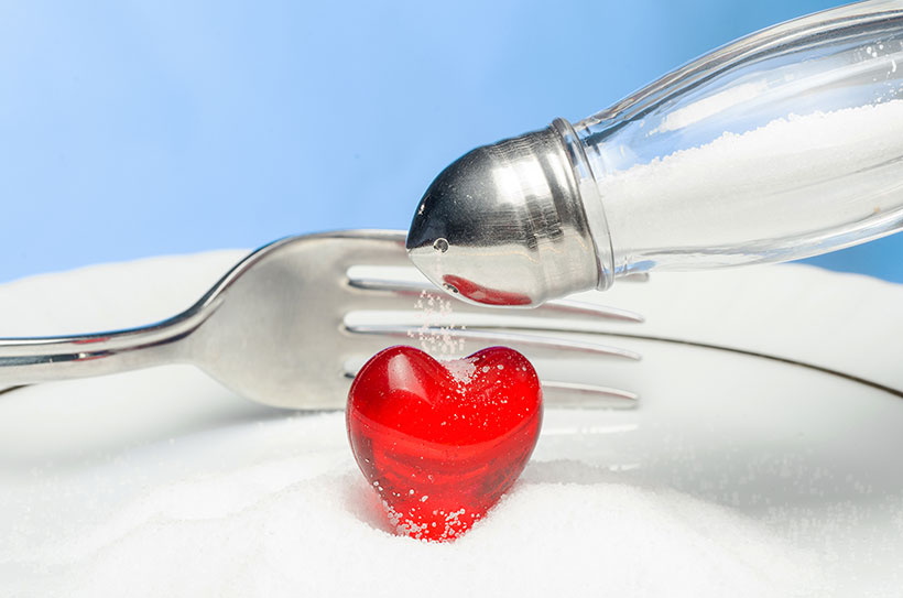 Picture of a heart and some salt - blood pressure theme.