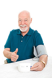 Picture of a Man Taking His Blood Pressure Reading While Feeling Happy