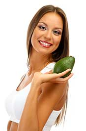 Picture of a Happy Woman Holding an Avocado.