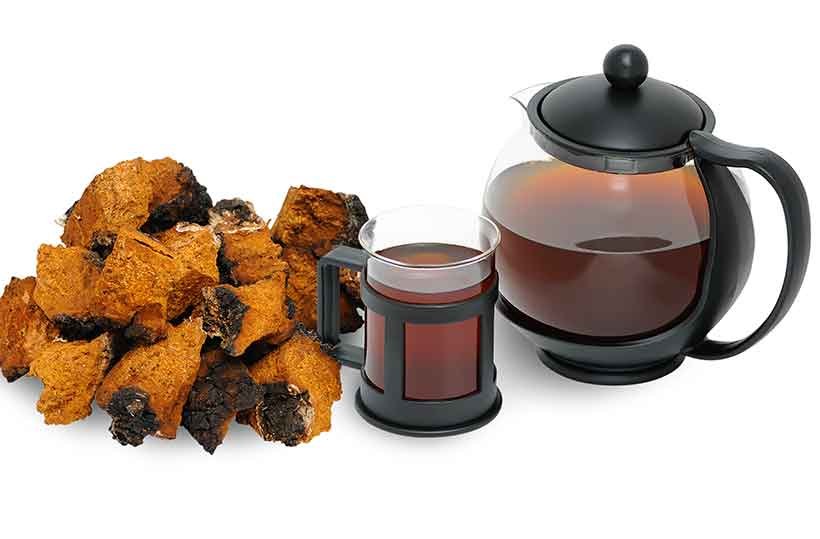 Picture of Dried Chaga Mushrooms, a Cup, and a Teapot.