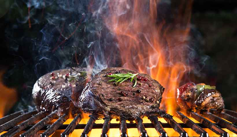Red Meat Cooking (and Burning) At High Heat Temperatures - Charred Steak.