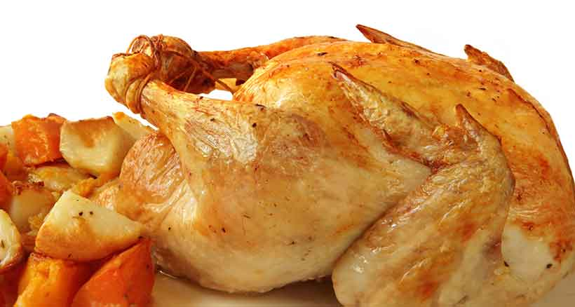 Freshly Cooked Roast Chicken With Skin and Vegetables.