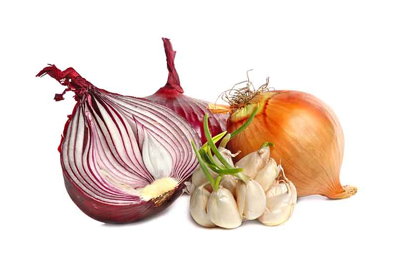 A Bulb of Garlic With Yellow Onion and Red Onion.