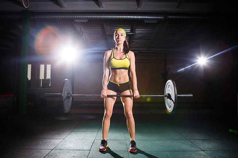 {icture of an Athletic Girl Doing Deadlifts in the Gym.