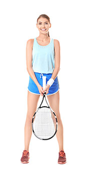 A Young Woman In Sporty Outfit With a Tennis Racket.